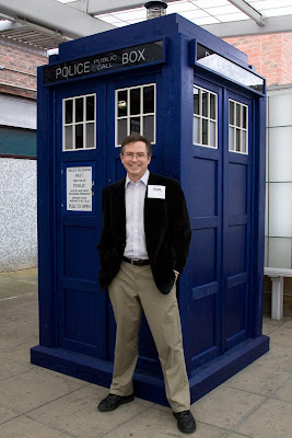 Jim Fruchterman in front of a blue police box/the Tardis from Dr.  Who