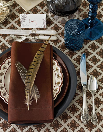 Thanksgiving table setting with pheasant feathers