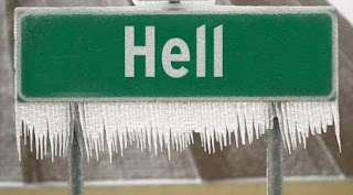 a frozen sign for the town of hell