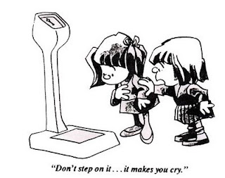2 girls looking at a scale