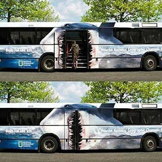 photo of a person getting on a bus that has been painted as a shark.