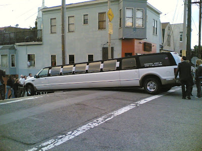 photo of a limo beached on a hill