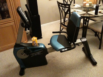 photo of an exercise machine with candy in the cup holder