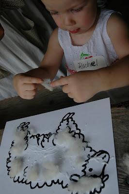 little girl making sheep craft activity