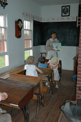 inside old school house with teacher in costume