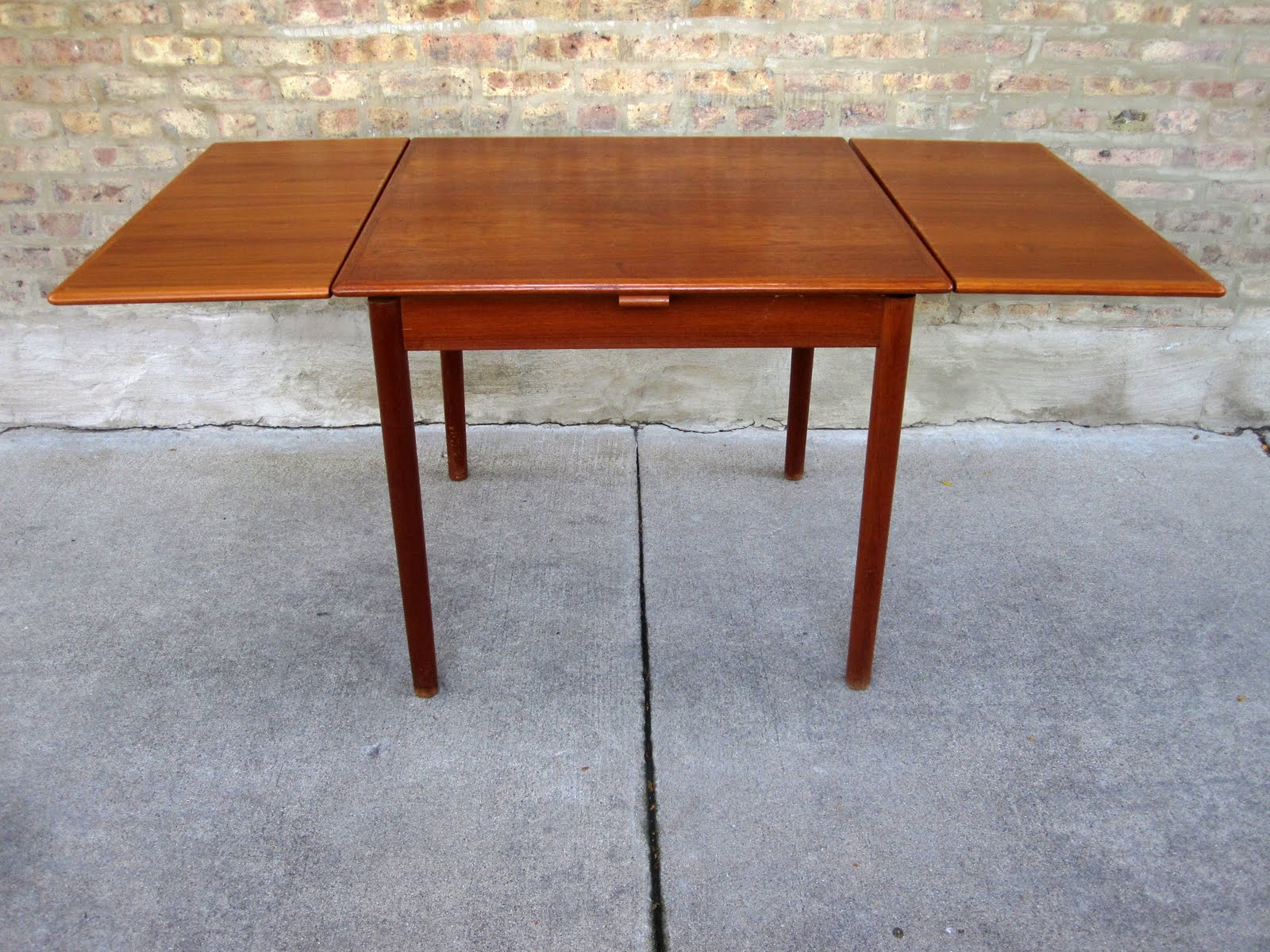 circa midcentury: 'danish modern' teak dining table