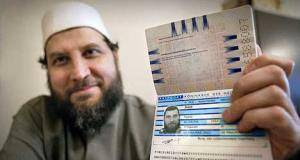 Fawaz Jneid showing his Dutch passport