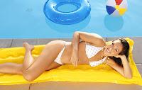 Jelena Jankovic lying poolside in her bikinis