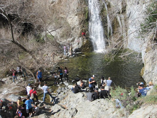 A crowd at Fish Canyon Falls