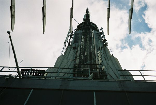 A closeup of the Empire State Building tower