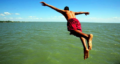 A boy jumps into the water of Cocibolca lake at the colonial city of Granada, some 29 miles south of Managua
