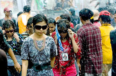 Young people are sprayed with water during the annual 'water festival' in Yangon, Myanmar