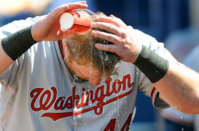 #44 of the Washington Nationals seeks pours water on his head during the game against the Atlanta Braves at Turner Field in Atlanta, Georgia