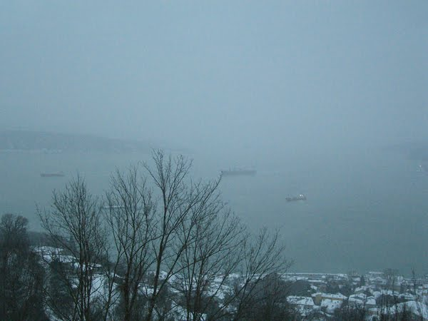 Boats on the Bosphorus in a snowstorm.
