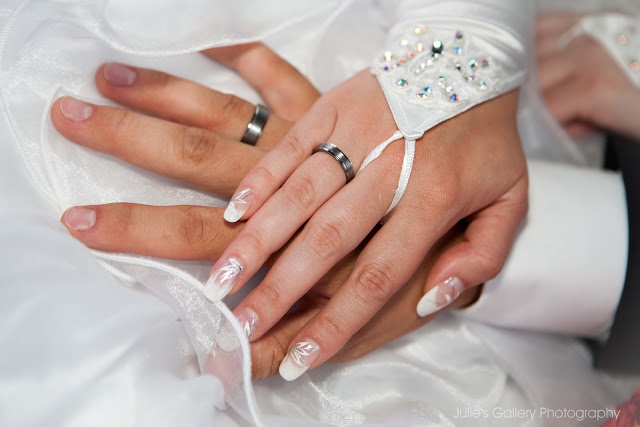 Image result for hands with wedding bands