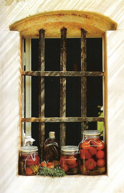 A Well Kept Home, preserves in glass bottles sitting on window sill, edited by lb for linenandlavender.net