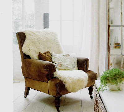 Leather chair and sheepskin rug, At Home with White, as seen on linenandlavender.net