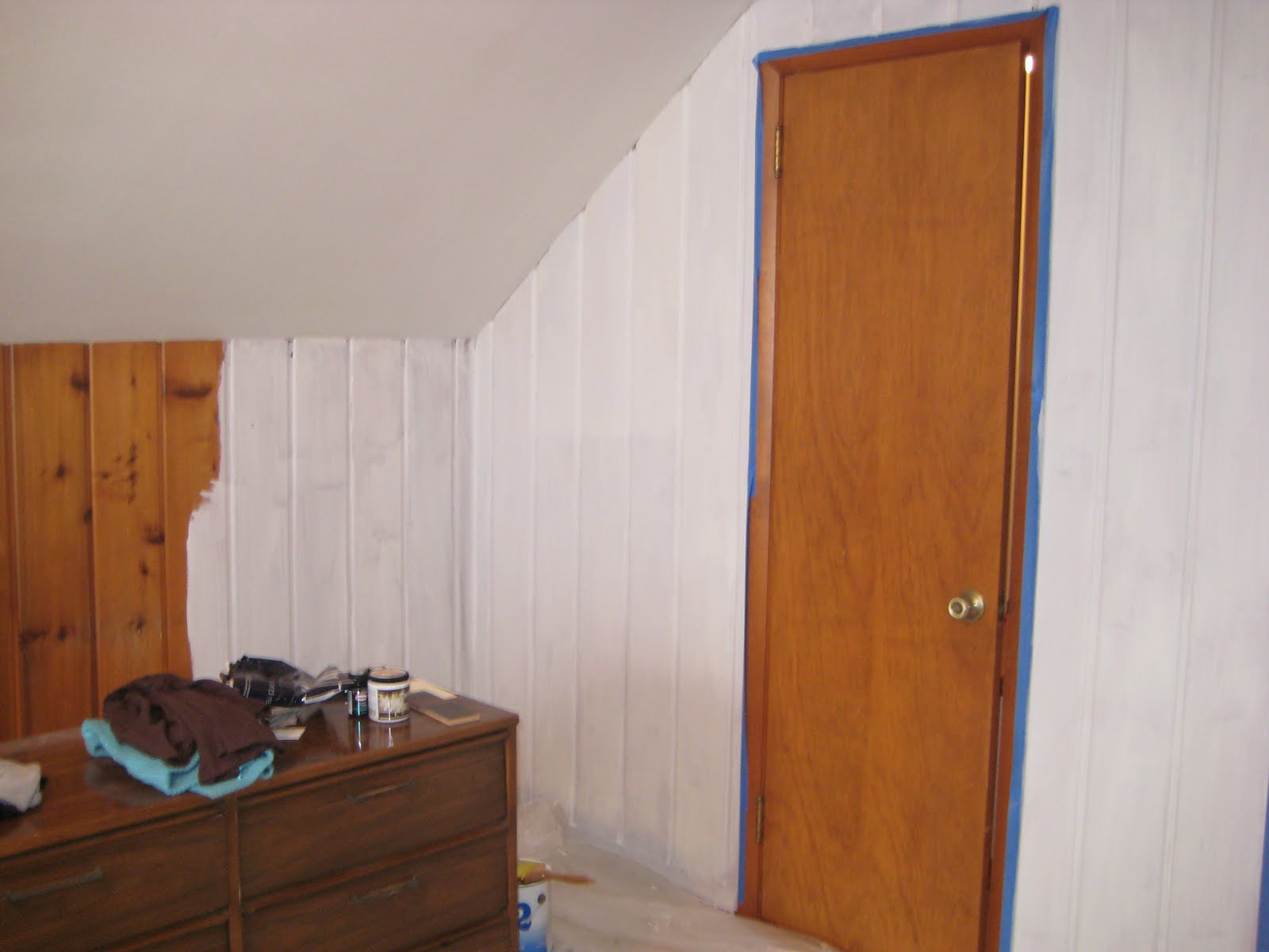 Remodelaholic painting over knotty pine paneling Ways to update wood paneling