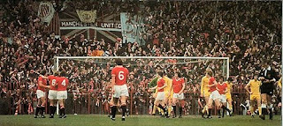 Manchester United team playing in front of the Stretford End