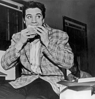 Elvis enjoys a sandwich.