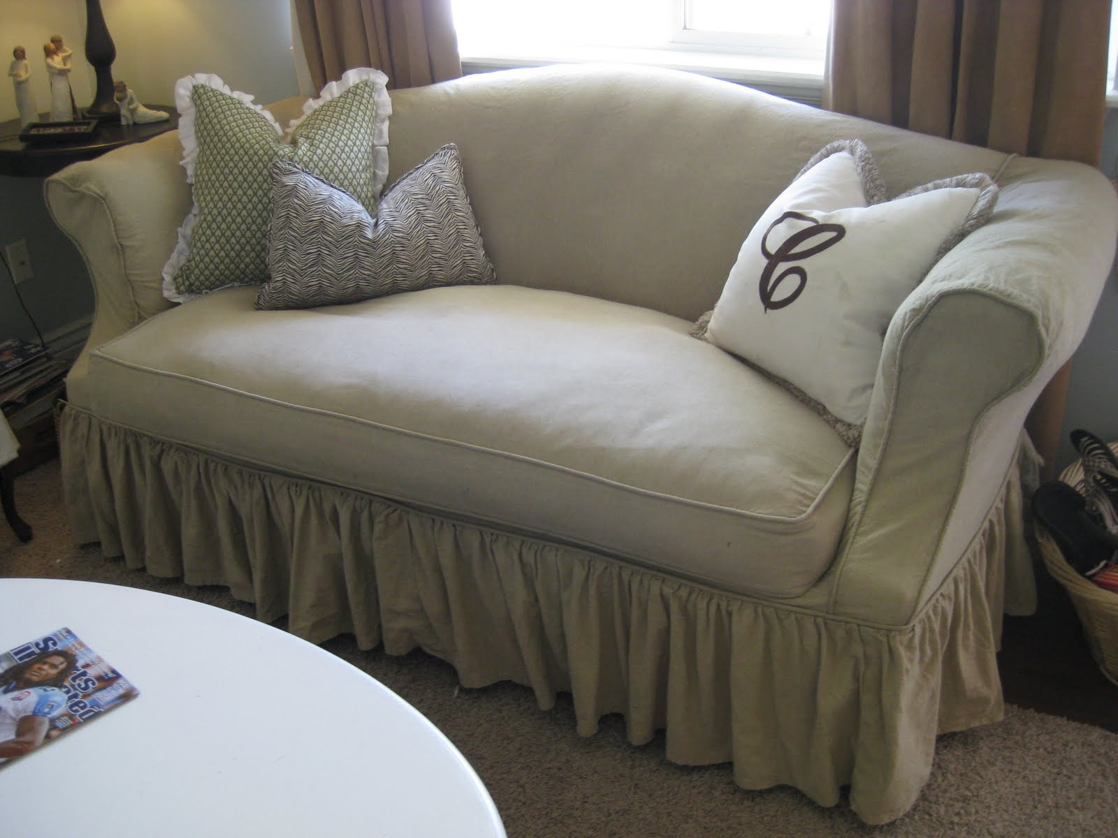 Remodelaholic Using Custom Made Slipcovers To Unify Your
