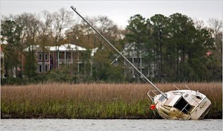 Officials are investigating a sailboat abandoned on the marshy banks of a creek in Mount Pleasant, S.C.