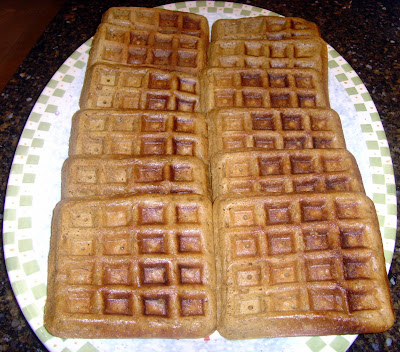 two rows of gingerbread waffles on a plate