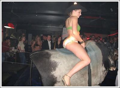 Ready sexy girl riding bull