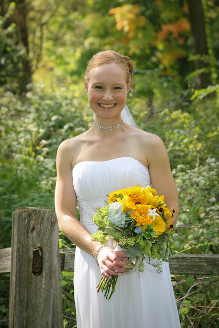 Bride and bouquet with Black-Eyed Susan created by Belle Fiori