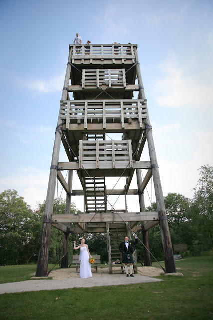 Bride and Groom pose by Lapham Peak State Park observation tower