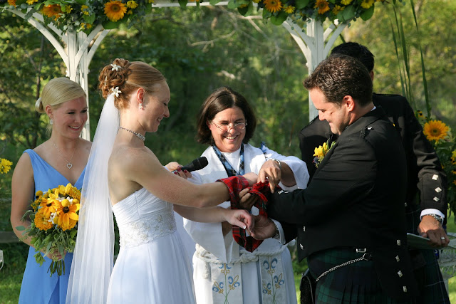 Binding of hands during wedding ceremony at Lapham Peak State Park
