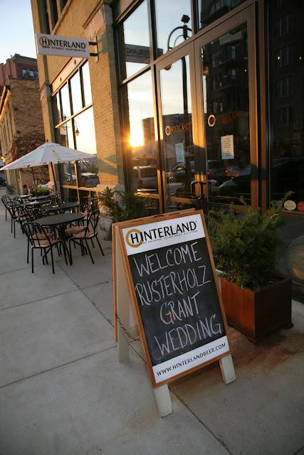 Sign board announcing Jonathan and Kristin's wedding reception at Hinterland Erie Street Gastropub in Third Ward