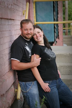 Portrait of engaged couple in alley