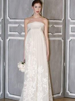 78dfde60e0 Hermoso vestido de novia de corte imperio, con escote palabra de honor y  una falda de gasa bordada con delicadas flores. La falda es recta con sutil  vuelo.