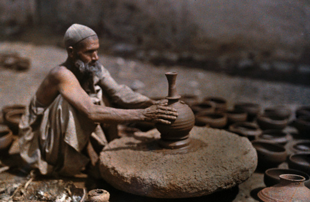 A man works at his potter's wheel -  Srinagar 1929
