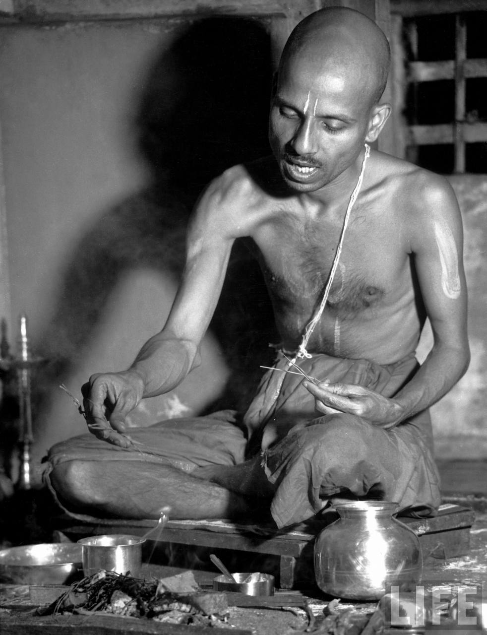 Brahmin man performing Hindu ceremony of changing the sacred thread - 1946
