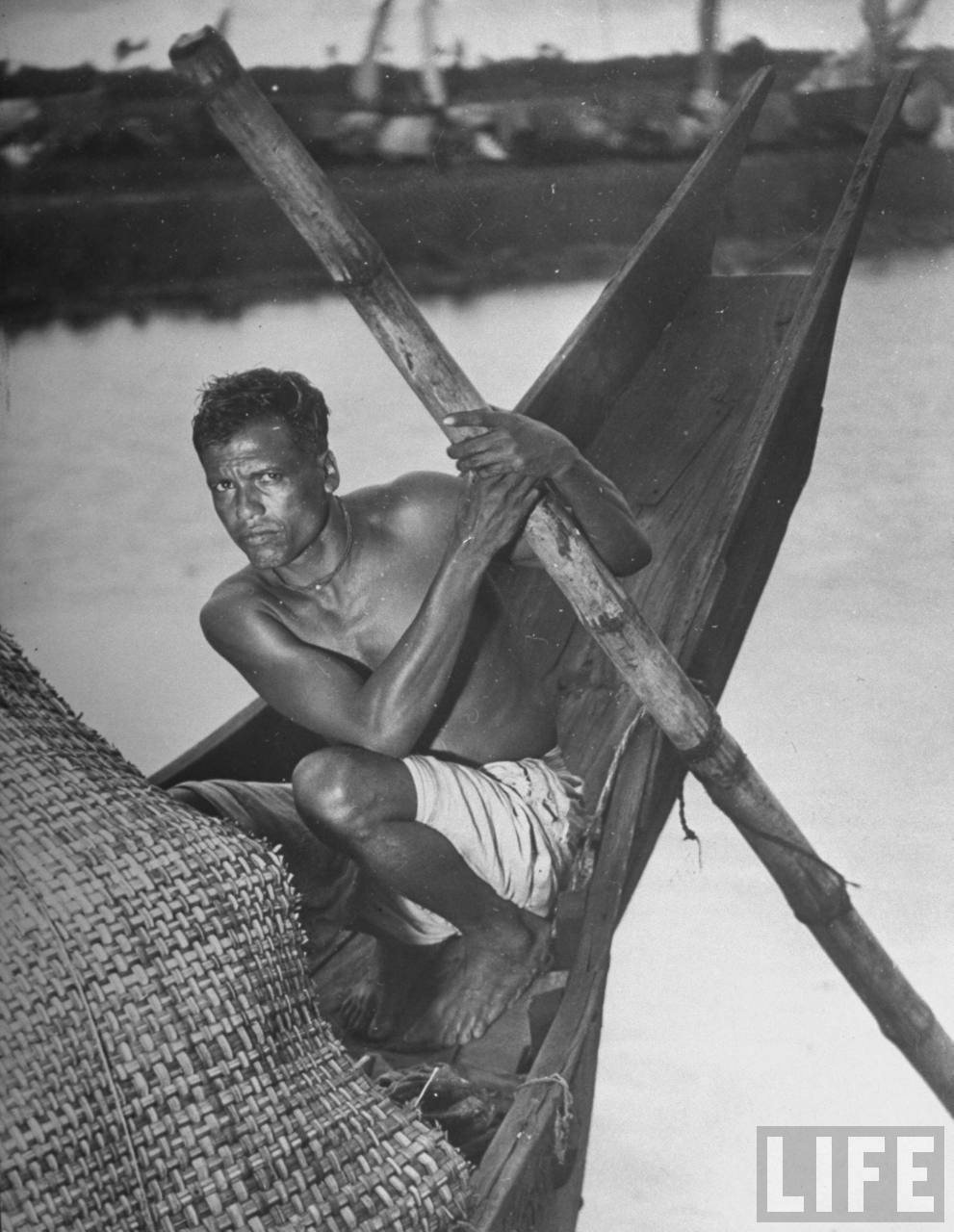 Indian boatman on river boat where he lives with his family - 1946