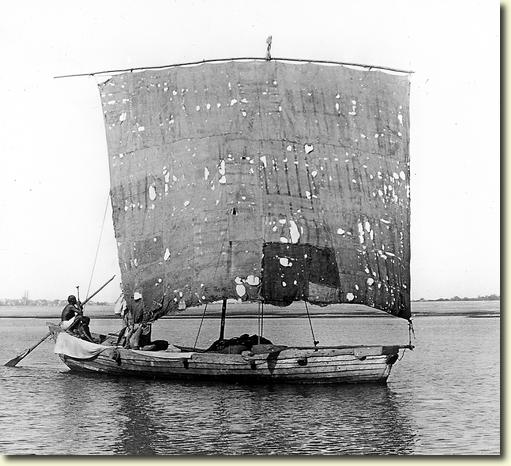 Indian boat with a square sail floating along the Ganges River - Bengal 1907