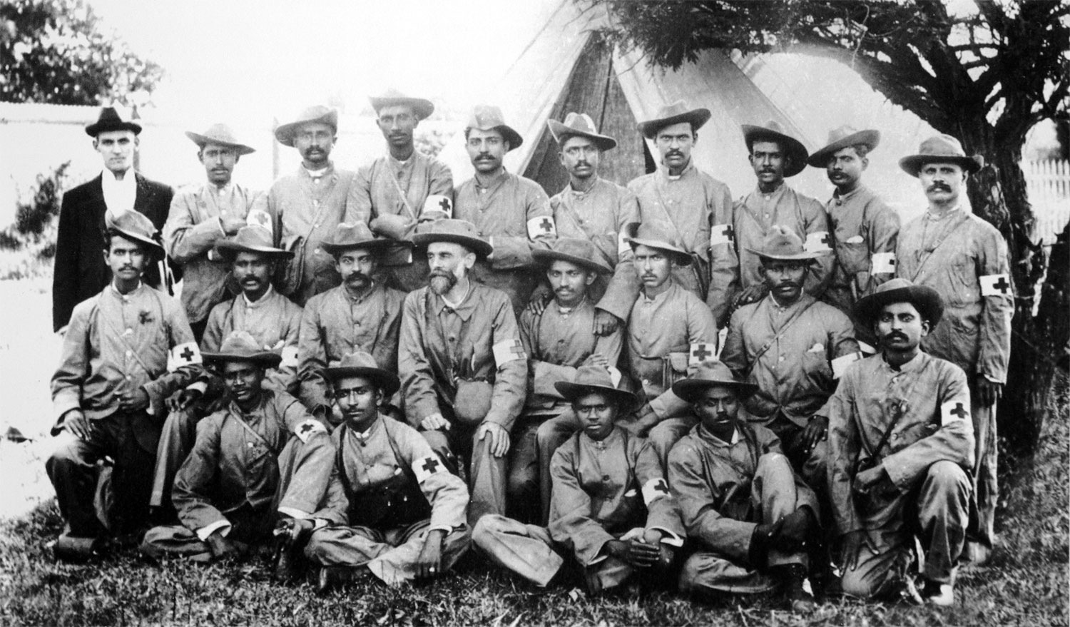 Mahatma Gandhi with the stretcher-bearers of the Indian Ambulance Corps during the Boer War, South-Africa - Between 1899 -1900