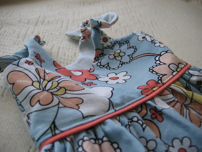ed6e2e4e2 This dress is made with two fabrics, one for the outside and one for the  lining. I also made my own bias tape out of the pinky-peach color, but it's  alot ...