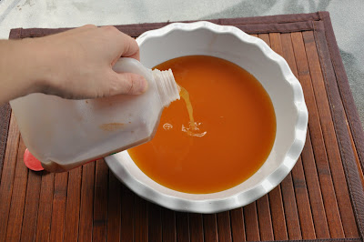 pouring apple cider in white bowl