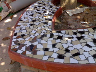 benches with broken tile inlay