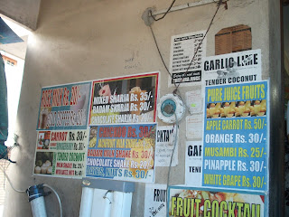 posters offering various juices