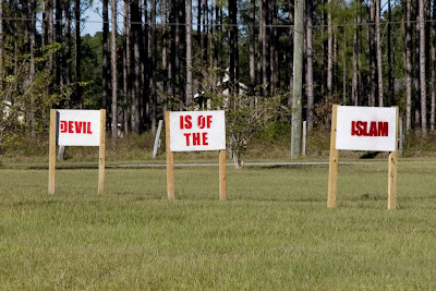'Islam is of the Devil' proclaim the signs on the grounds of the Dove World Outreach Center