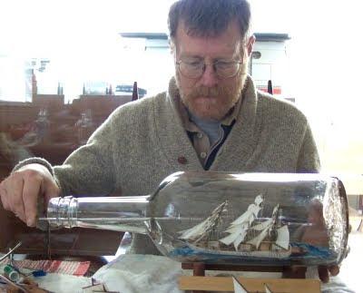 Jim Goodwin demonstrating ship in bottle