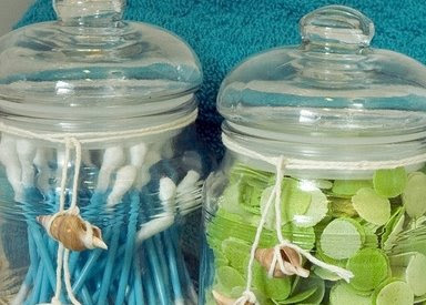 jars with twine ribbons and shells