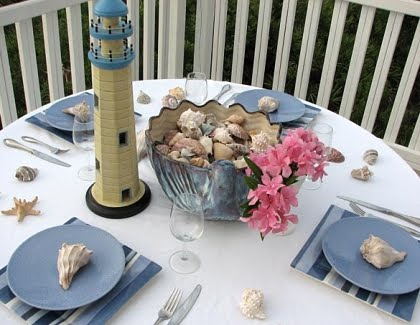 beach table with blue and lighthouse