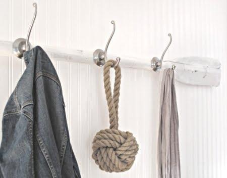 white painted oar wall rack