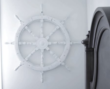 painted ship wheel on wall
