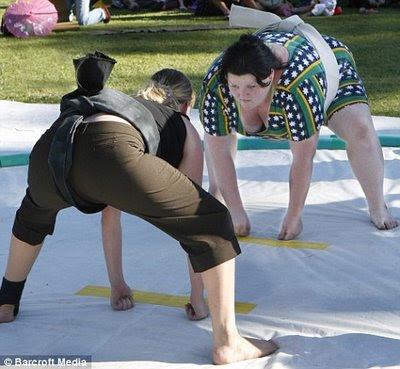 Female sumo wrestler Miki Satoyama gazes at her opponent
